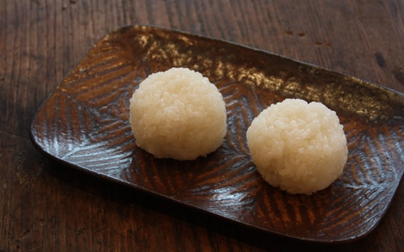 Delicious rice balls placed on top of the dish of Jo's work